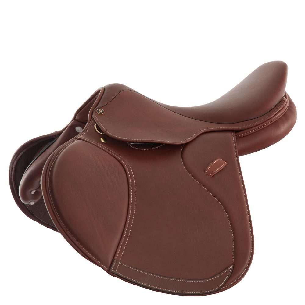 The BR jumping saddle Puccini II is made of vegetable-tanned leather, finished with soft aniline leather. Unlike the Puccini I, this model is equipped with interchangeable knee and calf blocks. The saddle has close contact panels filled with soft, resilient polyurethane foam to make the rider feel close to the horse. We tried to obtain a good balance point for the rider and in addition, the saddle is built slightly forward to provide optimum support when jumping. Its medium deep seat and generously filled knee pads are covered with extra soft leather to allow for optimum comfort. Small, firm knee and calf blocks ensure a proper position of the rider's leg and great support. The blocks are detachable through the use of Velcro. The saddle is built on a flexible polythene saddle tree and is fitted with billets made of chrome-tanned latigo leather, which ensure a secure saddle position. The bottom of the flap has been reinforced with leather to prevent wear caused by the stirrup leathers. In addition, parts of the flap edge are padded for a beautiful look. Contrast stitching adds a stylish touch as well. The saddle comes with a luxurious, lined BR saddle cover which has a storage compartment for the girth as well.