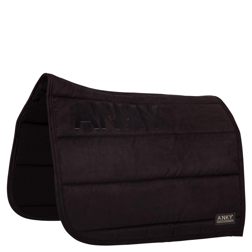 The exterior of the ANKY® Saddle Pad is made of tactile suede with non-skid silicone print on both sides to avoid movement of the saddle. The interior fabric is designed with Coolmax® to provide optimal moisture management. The thick filling inside ensures the saddle will remain perfectly in place and pressure is divided evenly.