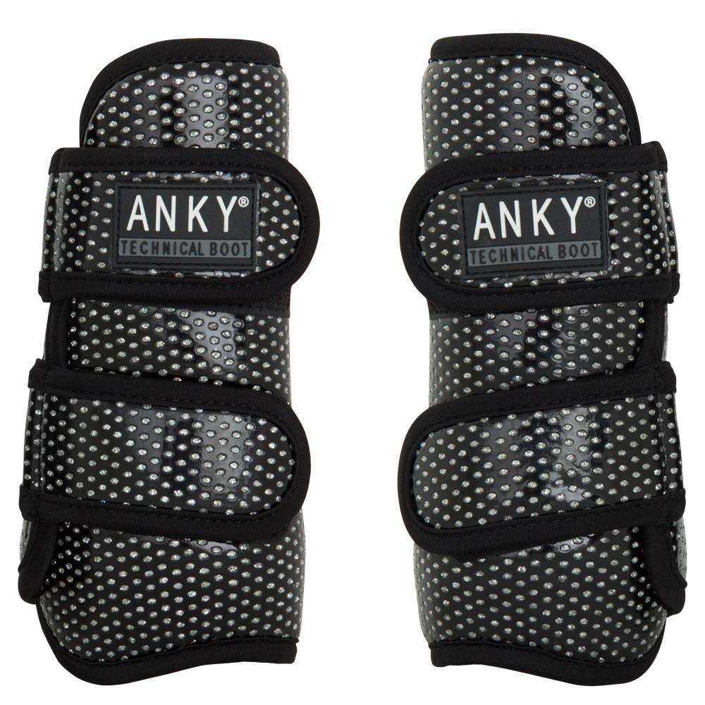 <i>The ANKY® Climatrole horse boots set a new standard when it comes to leg protection!</i><br><br>Both the flexible, yet shockproof synthetic shell and the shock-absorbing neoprene lining are perforated. These perforations encourage the natural flow of air, as a result of which heat and moisture can be transported easily. In addition, the boots are equipped with the registered I.4U Heat Dispenser System in the form of aluminium collectors on the skin side. These small metal discs collect the heat of the leg and transport it to the outer of the boot. The aluminium remains cool during this process. The horse boots are not glued together to make sure that the technical functions are not blocked. The outer of the boot is finished with perforated synthetic patent leather. The underlying technical metal coating shines through the perforations, which allows for a glittery look. The lightweight boots have secure Velcro closures and can be put in the washing machine. Complete the set with the ANKY® over reach boots Climatrole Shiny, item A31200, or the ANKY® over reach boots Climatrole Soft & Shiny, item A31203.
