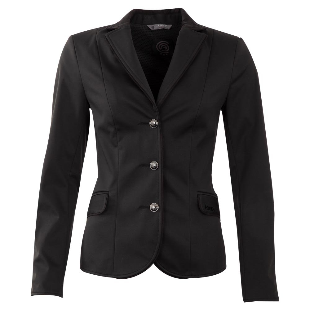 <i>Looking for an elegant, subtle look? Say no more!</i><br><br> This competition jacket fits like a glove due to the stretchy material and will make you forget all about your competition stress! Even though this subtle, classic jacket is a polar opposite of the competition jackets with an overload of bling, it stands out for its perfect simplicity. The subtle black suede piping along the lapels, flaps, sleeve slit and back waistband gives the jacket an extra accent. The striking shiny black buttons at the front and the sleeve are a perfect addition that do not detract from the classic look. <br><br>Fabric: 100% polyester